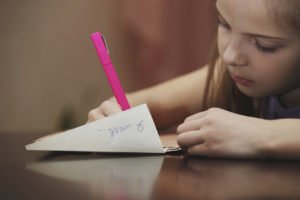 The girl writes a letter